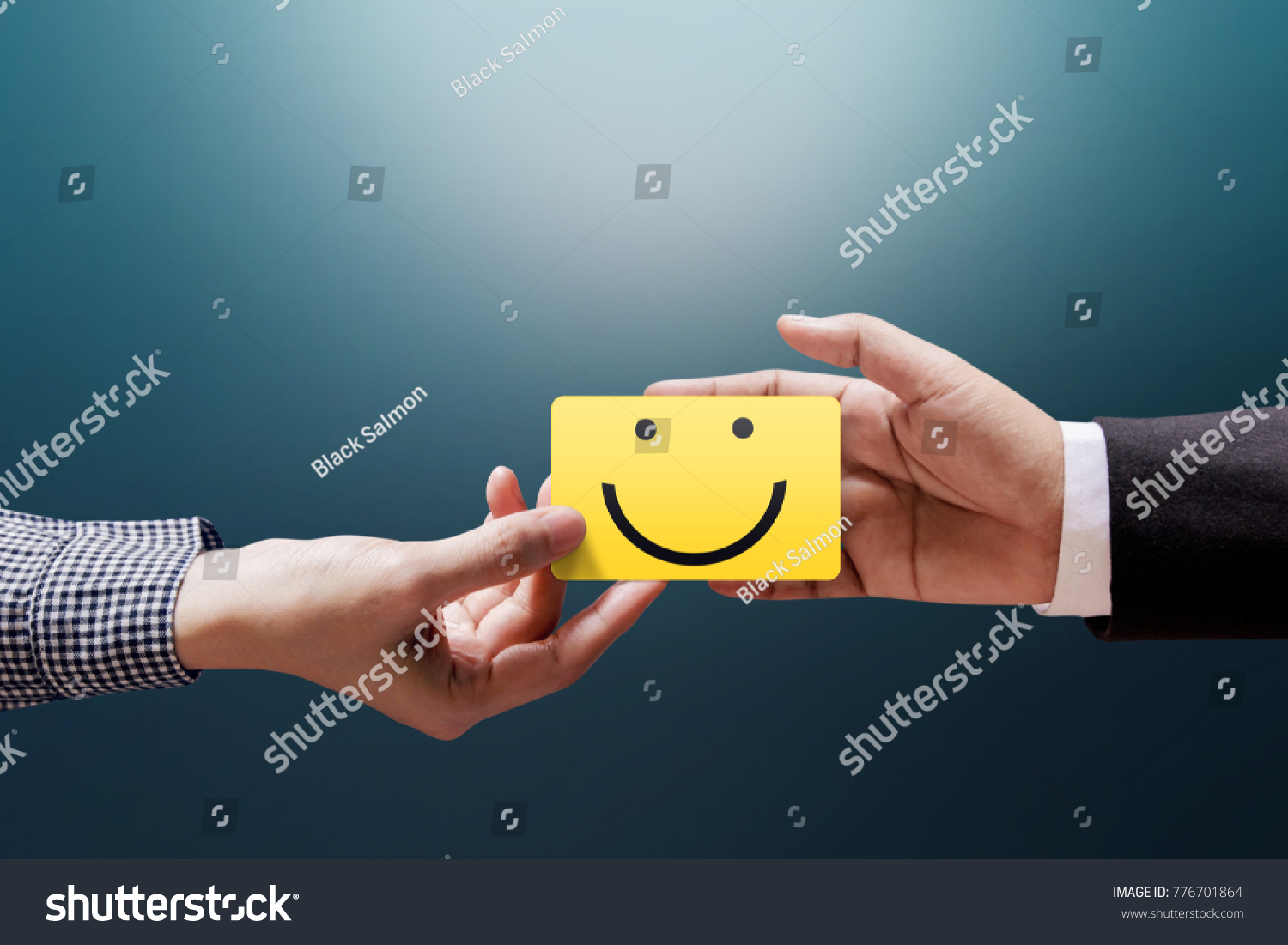 Customer Experience Concept, Happy Client Woman giving a Feedback with Happy Smiley Face Card into a Hand of Businessman #776701864