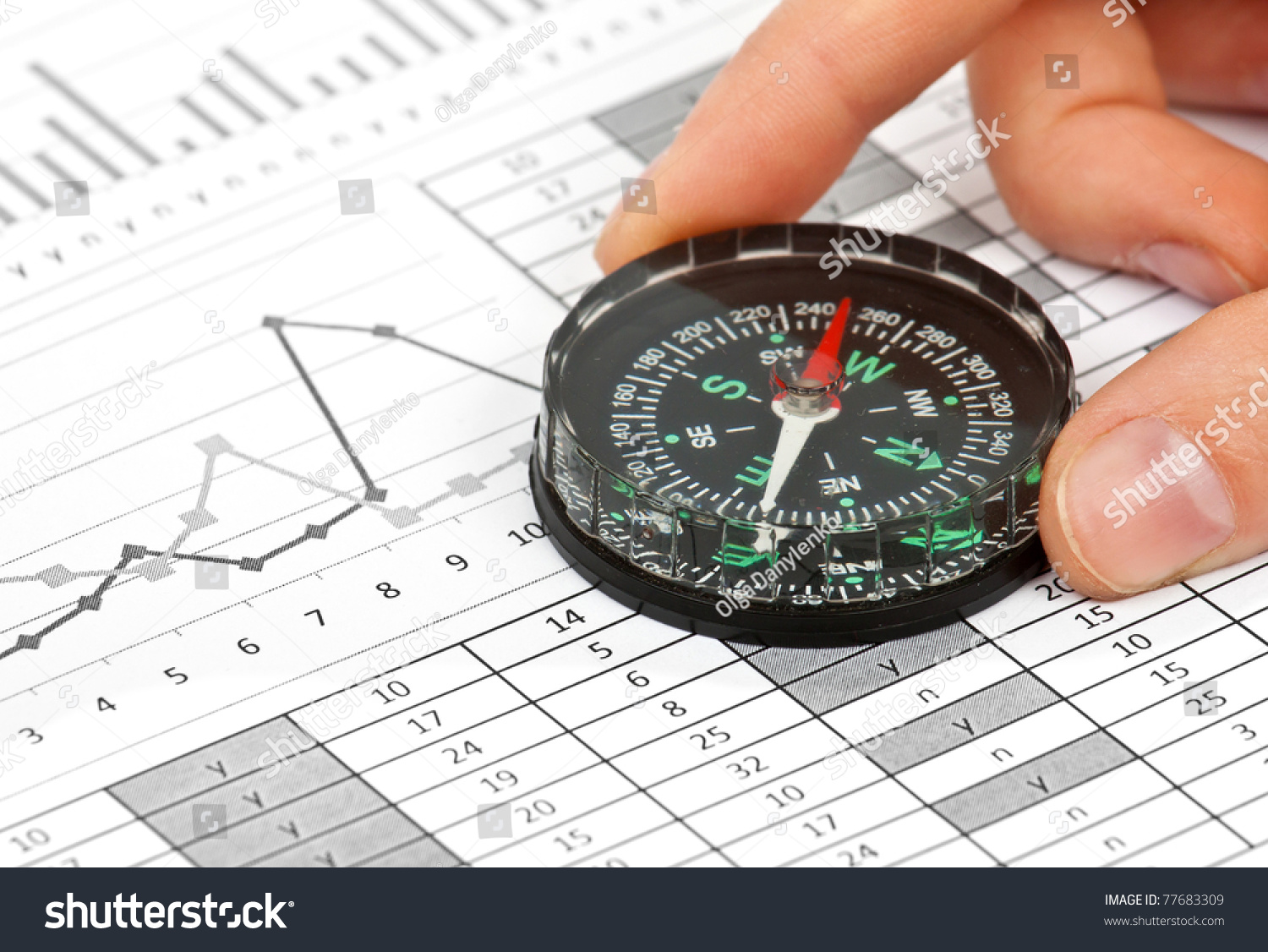 Business navigation concept compass diagram graph stock photo business navigation concept with compass and diagram or graph pooptronica