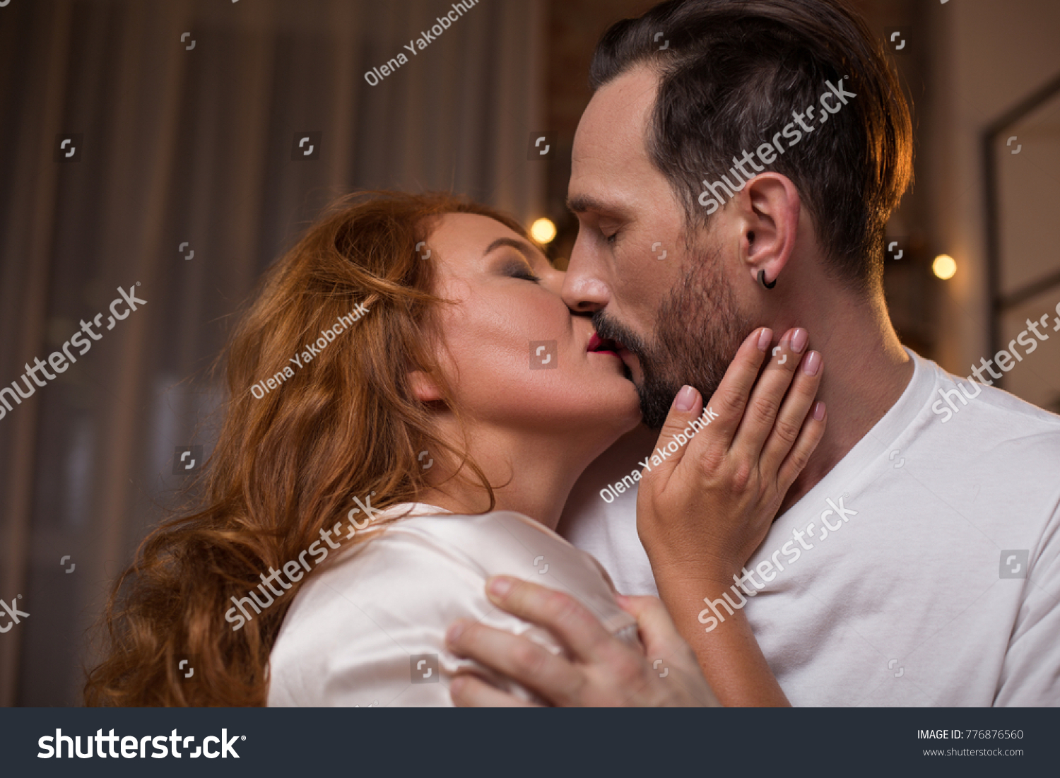 cute mature loving couple kissing affection stock photo (royalty