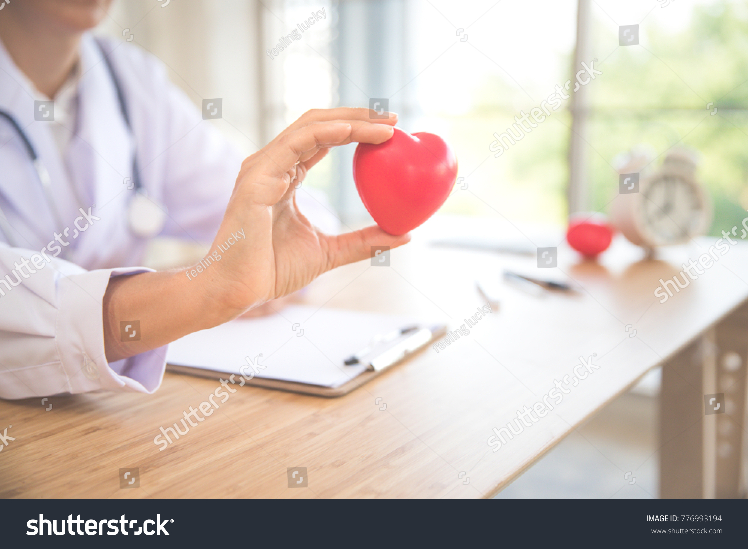 doctor holding and giving a red heart of love and care (this image for medical concept) #776993194