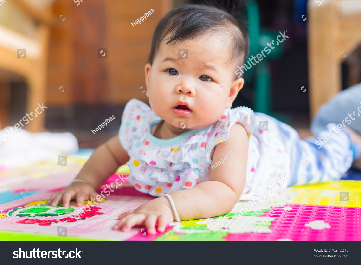 cute baby crawling this first time stock photo (edit now) 778210216