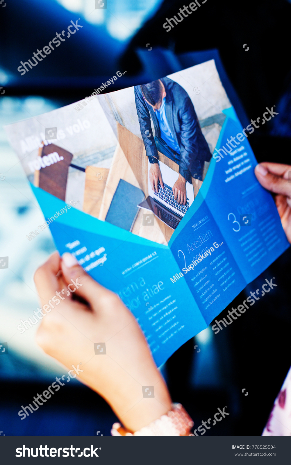 Hands holding a business brochure #778525504