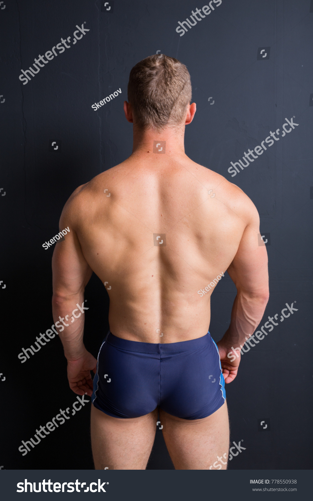 young athletic male with an athletic figure. part of body: back is broad,