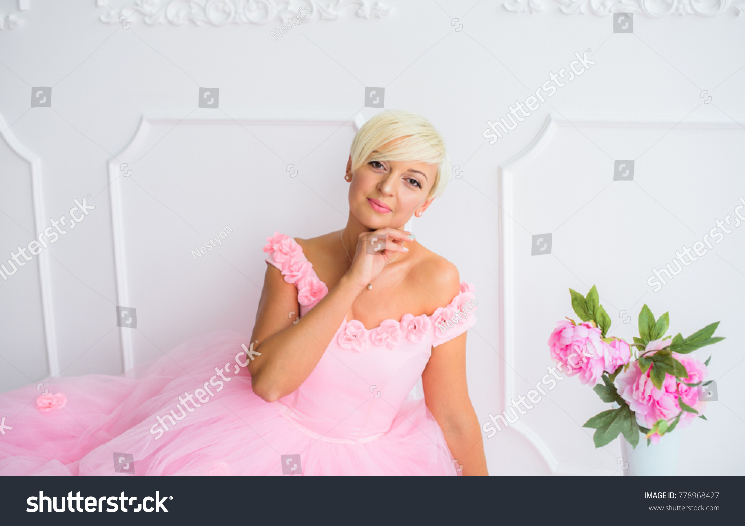 Beautiful girl beautiful pink dress pink stock photo 778968427 the beautiful girl in a beautiful pink dress and pink in palace a unbeatable beauty izmirmasajfo Image collections