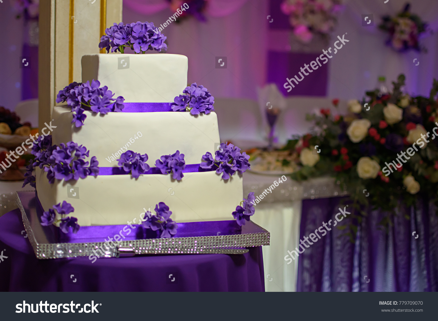Threetiered White Cake Purple Flowers Stock Photo Edit Now