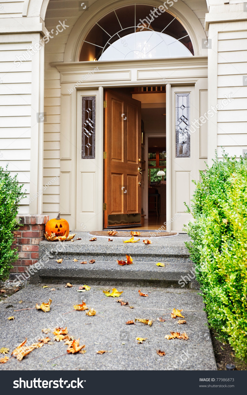 Front Path Steps And Open Front Door With Fall Leaves And