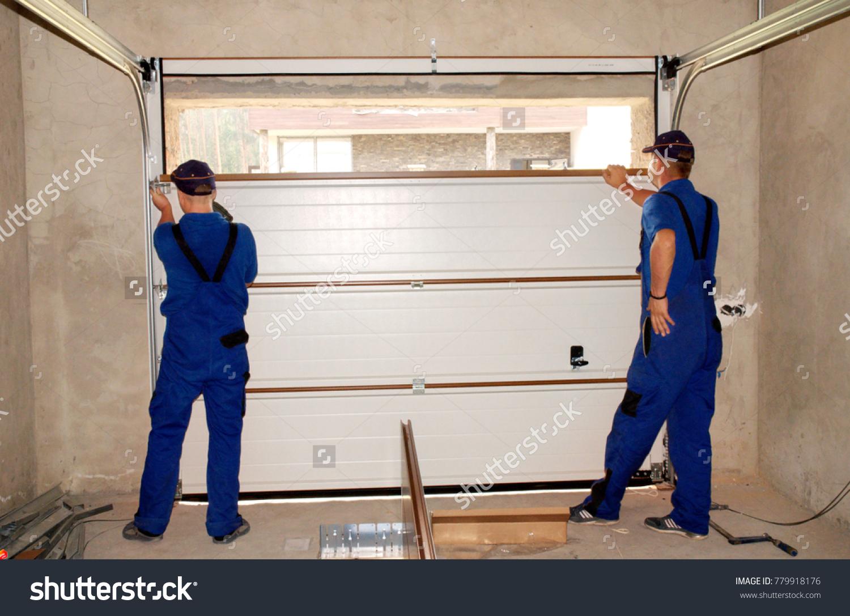 seal stock contractors installing insulating for insulation photo image replacement repair door garage