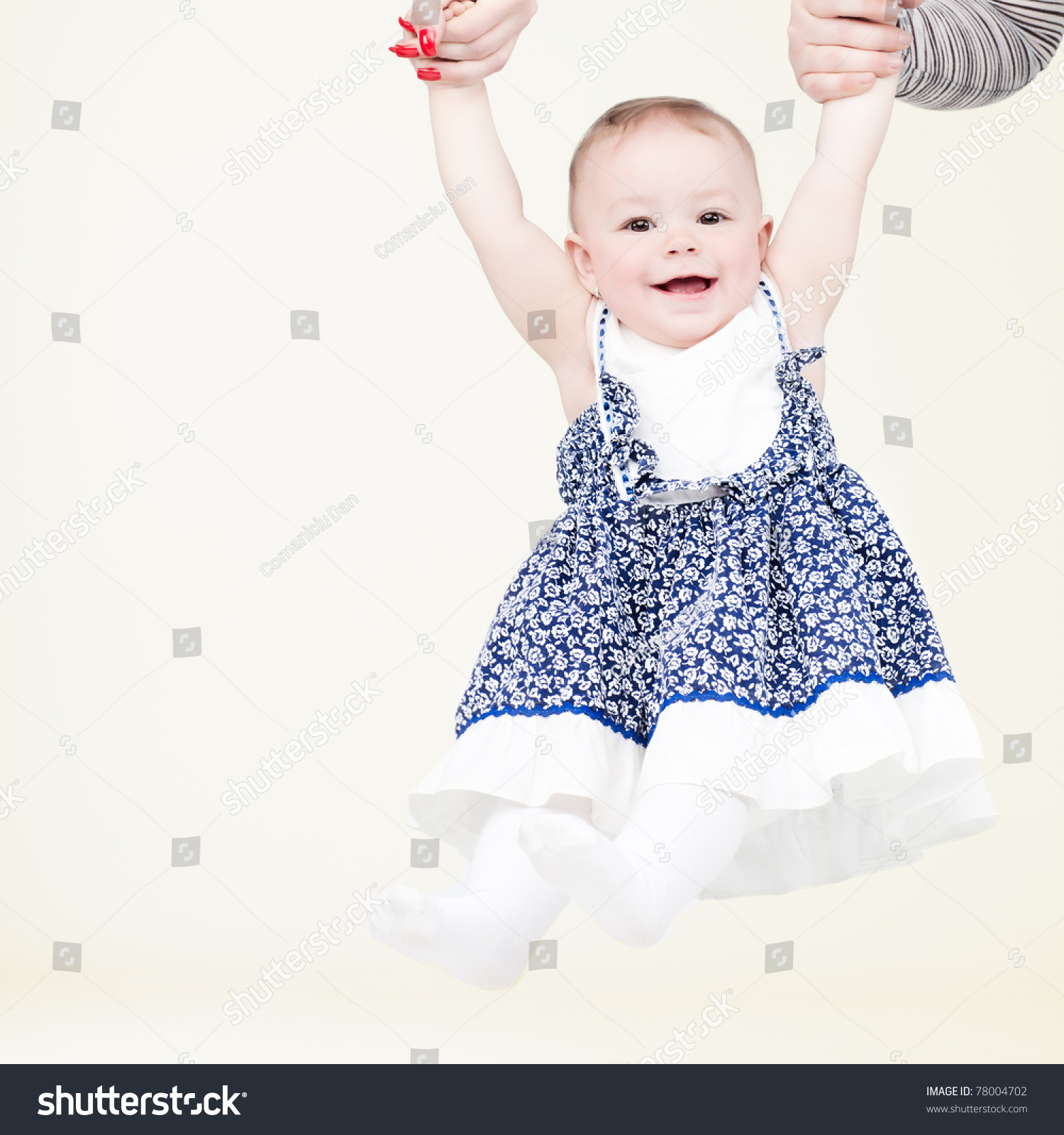 Laughing baby swinging