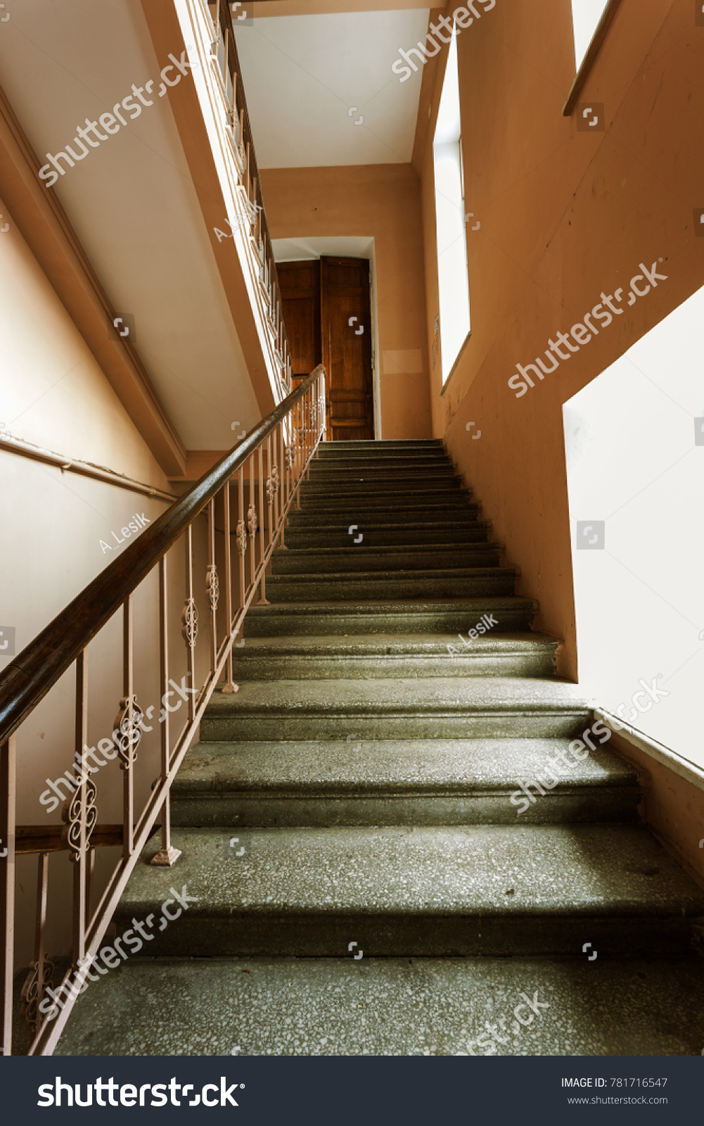 Cement, stone stairs of the old building. A vintage stone staircase between the floors of an obsolete building. Building fashion and technology of the 20th century in the USSR #781716547