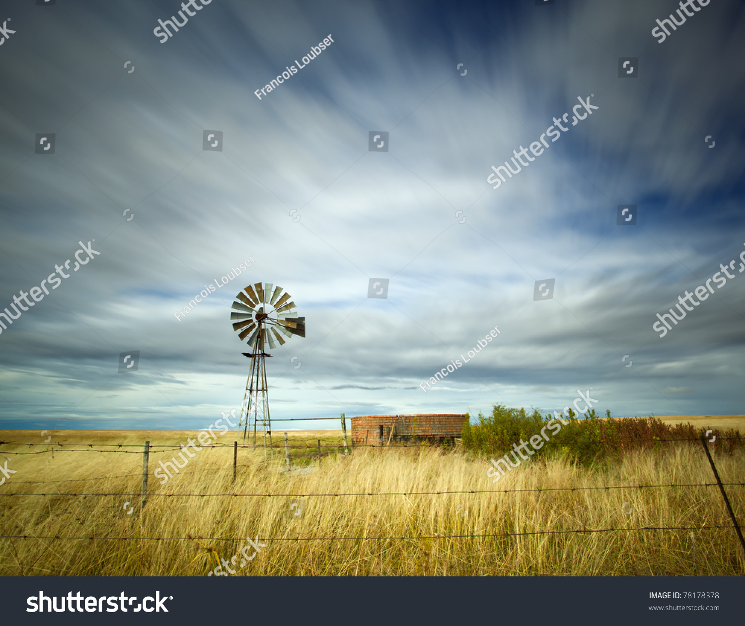Windmill In Field With Motion In The Clouds Stock Photo ...