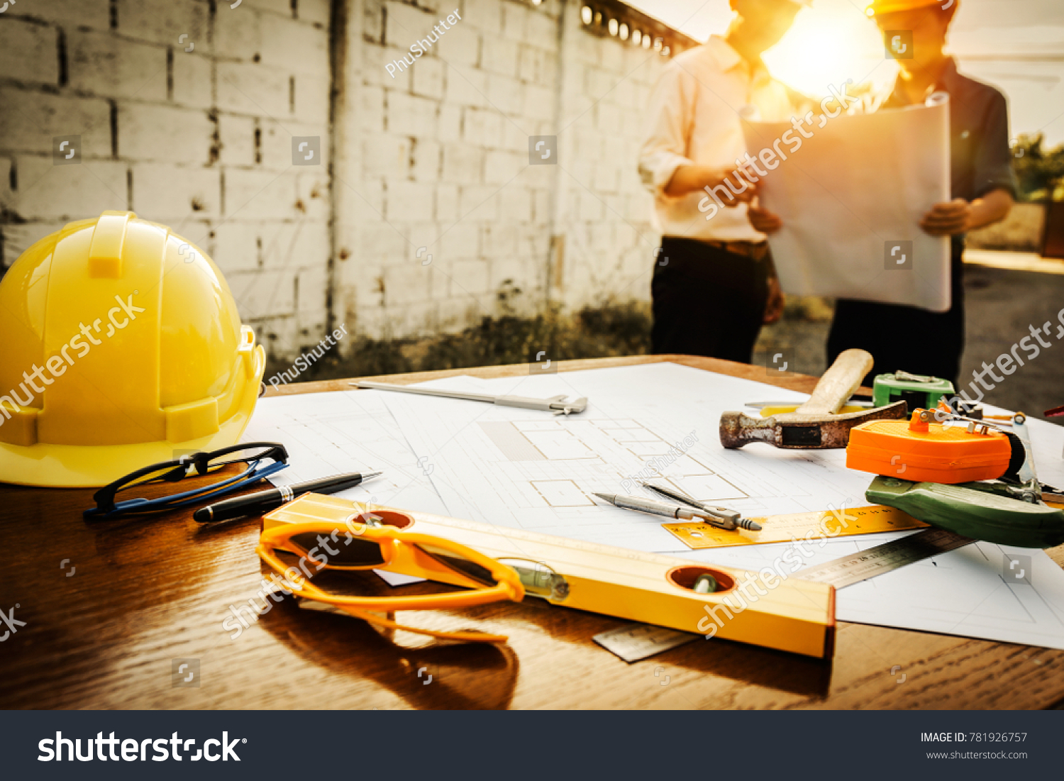 A desk of engineers who are studying the area for laying foundation of energy saving homes and raw material costs. #781926757