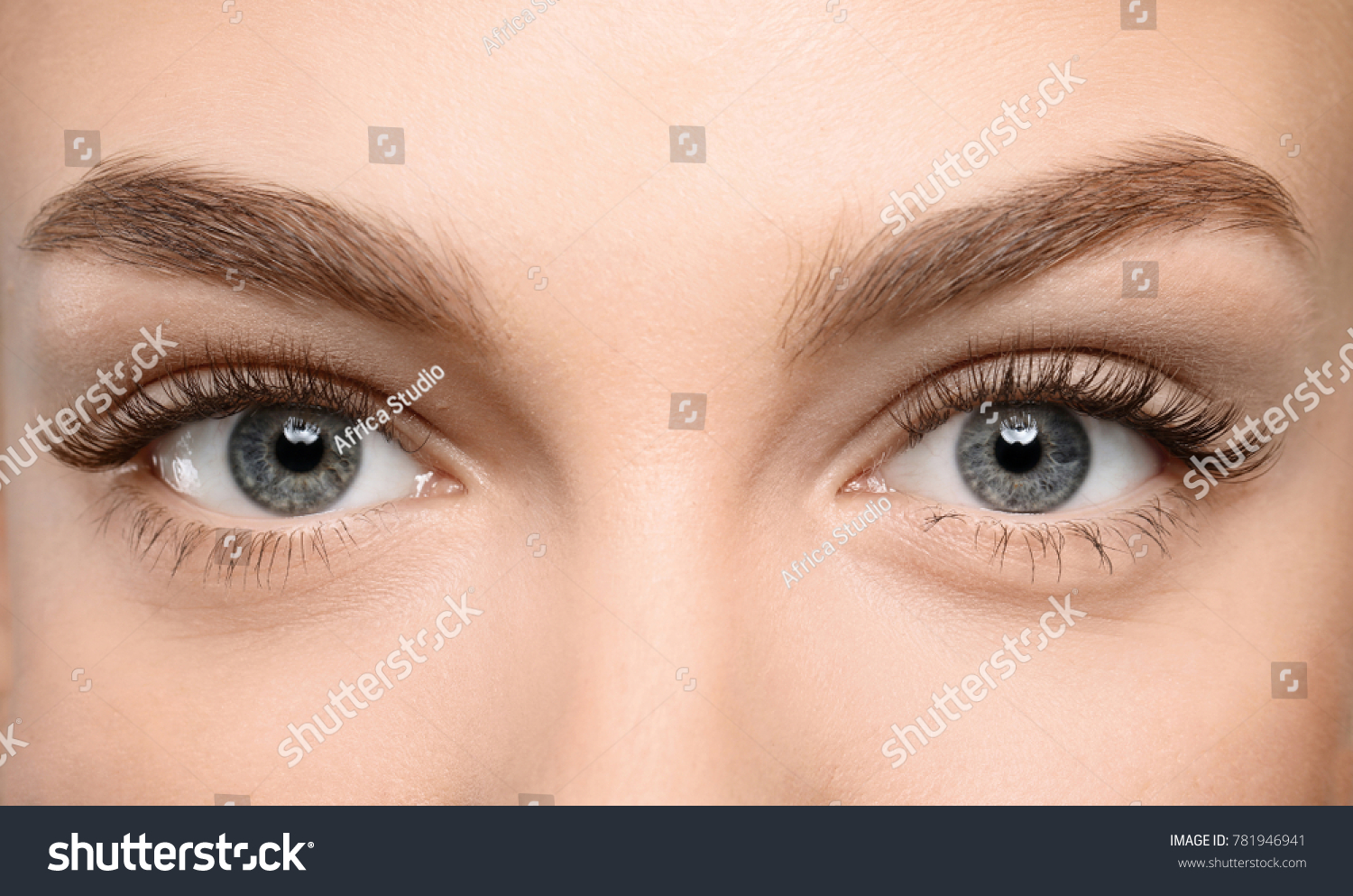 Beautiful female eyes with long eyelashes, closeup #781946941 - 123PhotoFree.com