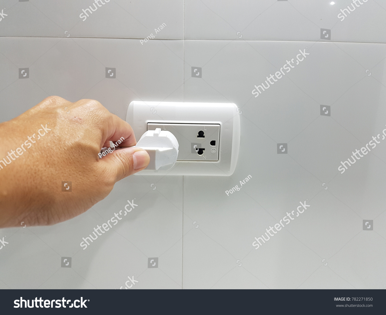 Hand Put Plug Socket On Wall Stock Photo (Edit Now) 782271850 ...