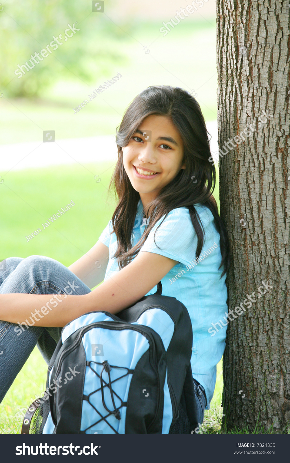 Young Teen Girl Sitting Against Tree Stock Photo 7824835 -7573