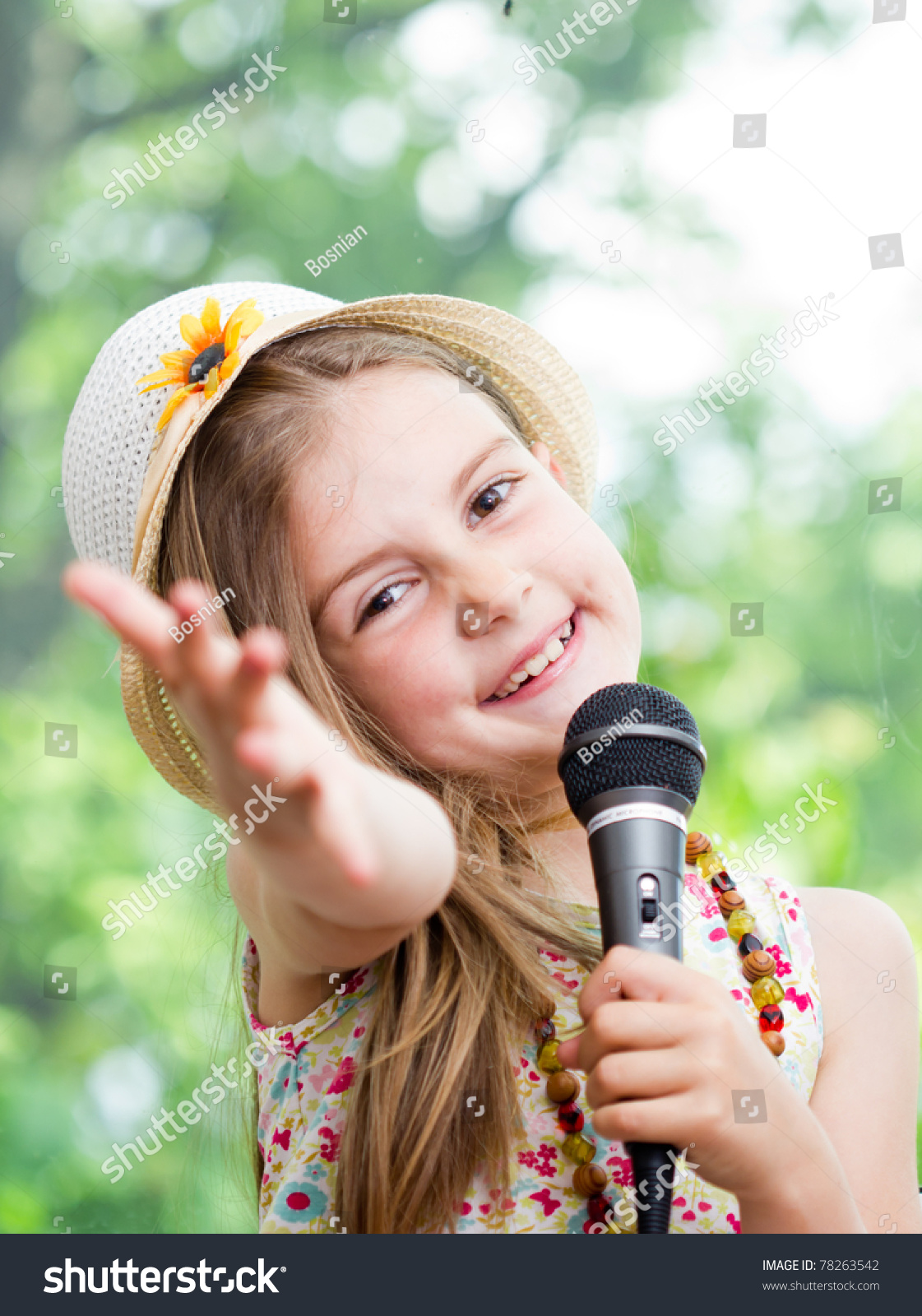 pretty little girl microphone her hands stock photo. Black Bedroom Furniture Sets. Home Design Ideas