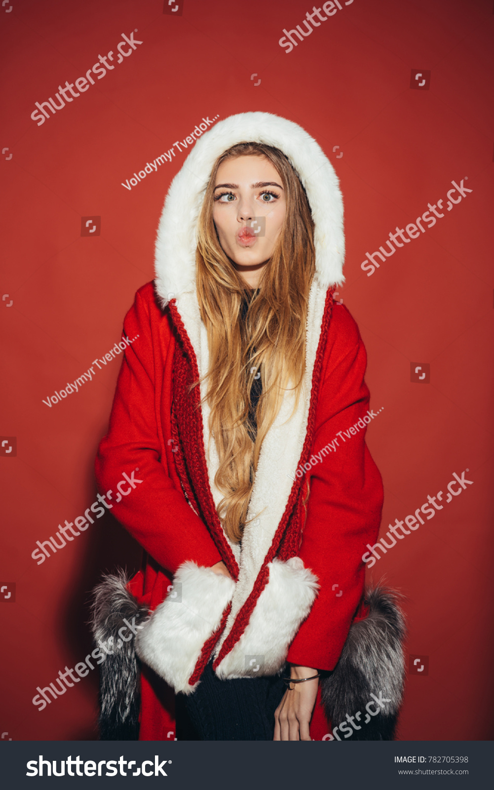 705deb15c3 New year and christmas. Happy girl celebrate new year on red ...