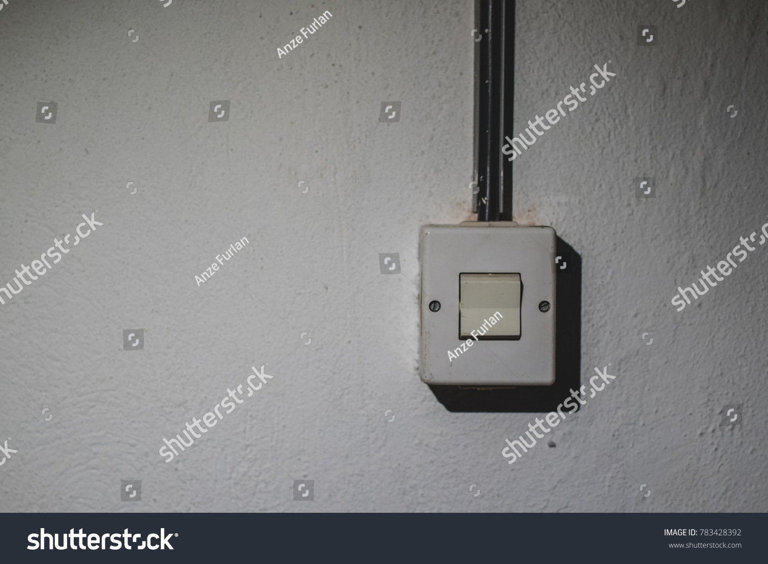 One Old Light Switch Mounted On Stock Photo Edit Now 783428392 Wiring A Plug Socket From The Stained Wall An Electrical Wire Is Seen Going