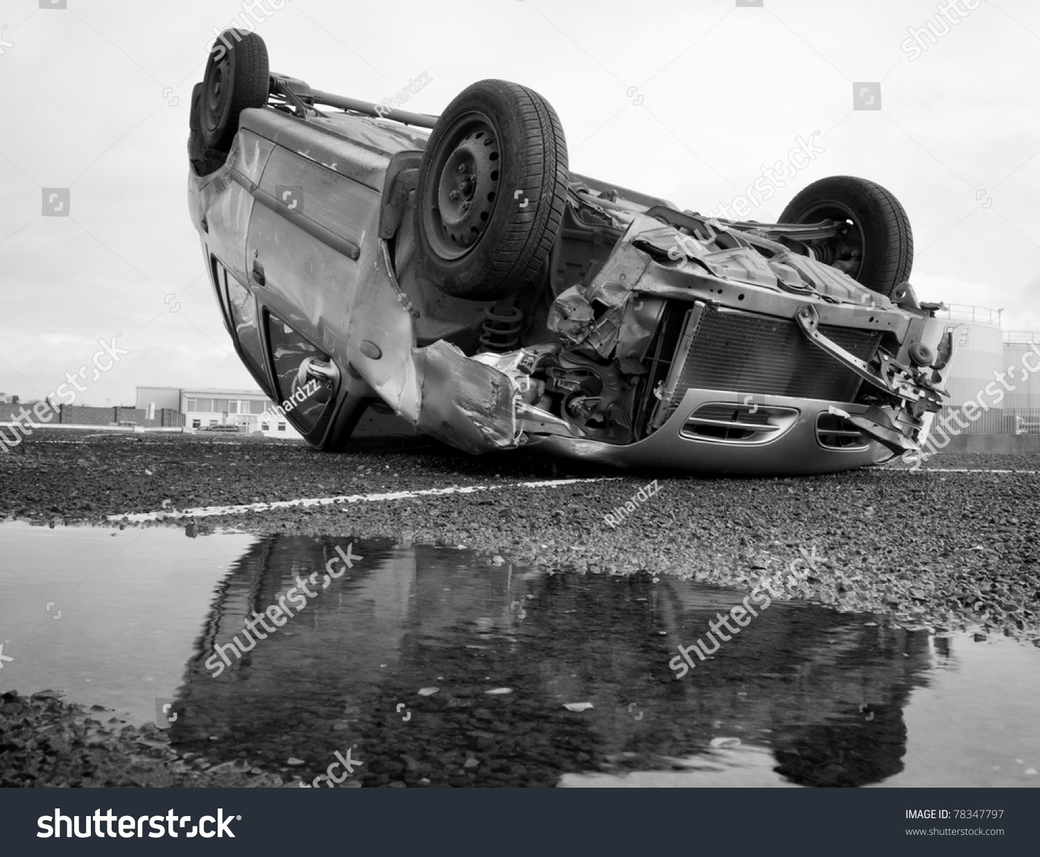 car turned upside down after road collision and reflection in the water stock photo 78347797. Black Bedroom Furniture Sets. Home Design Ideas