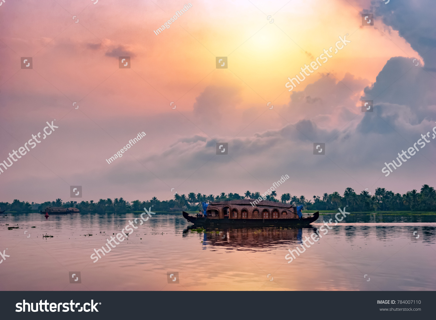 Alleppey, Kerala, India - October 15, 2007 : Backwater tourism is an important tourism attraction in this city of Kerala; Houseboats are seen all over the backwater streams carrying tourists  #784007110