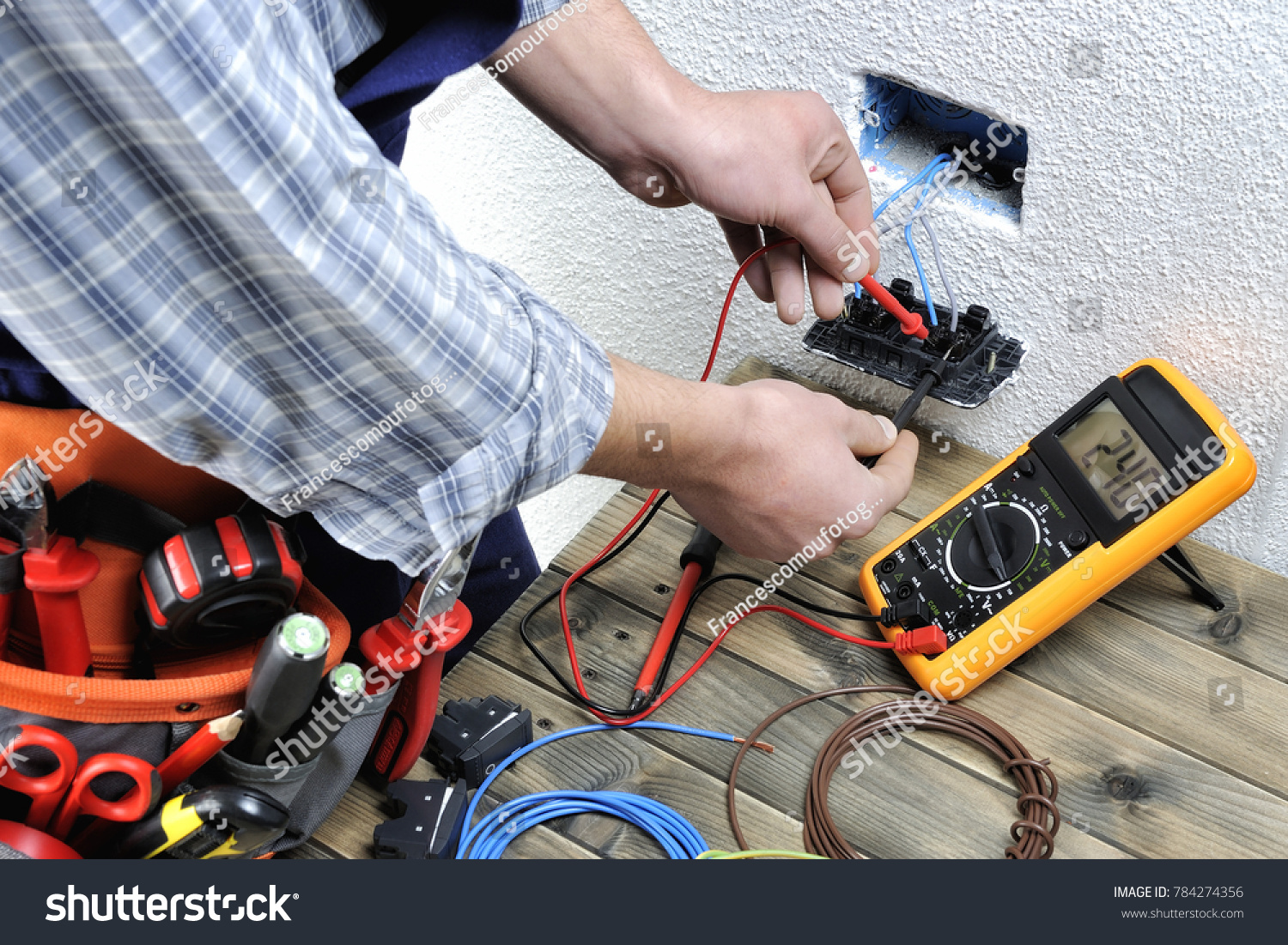 Young Electrician Work Measures Voltage Residential Stock Photo Wiring Installation At The Of A Electrical