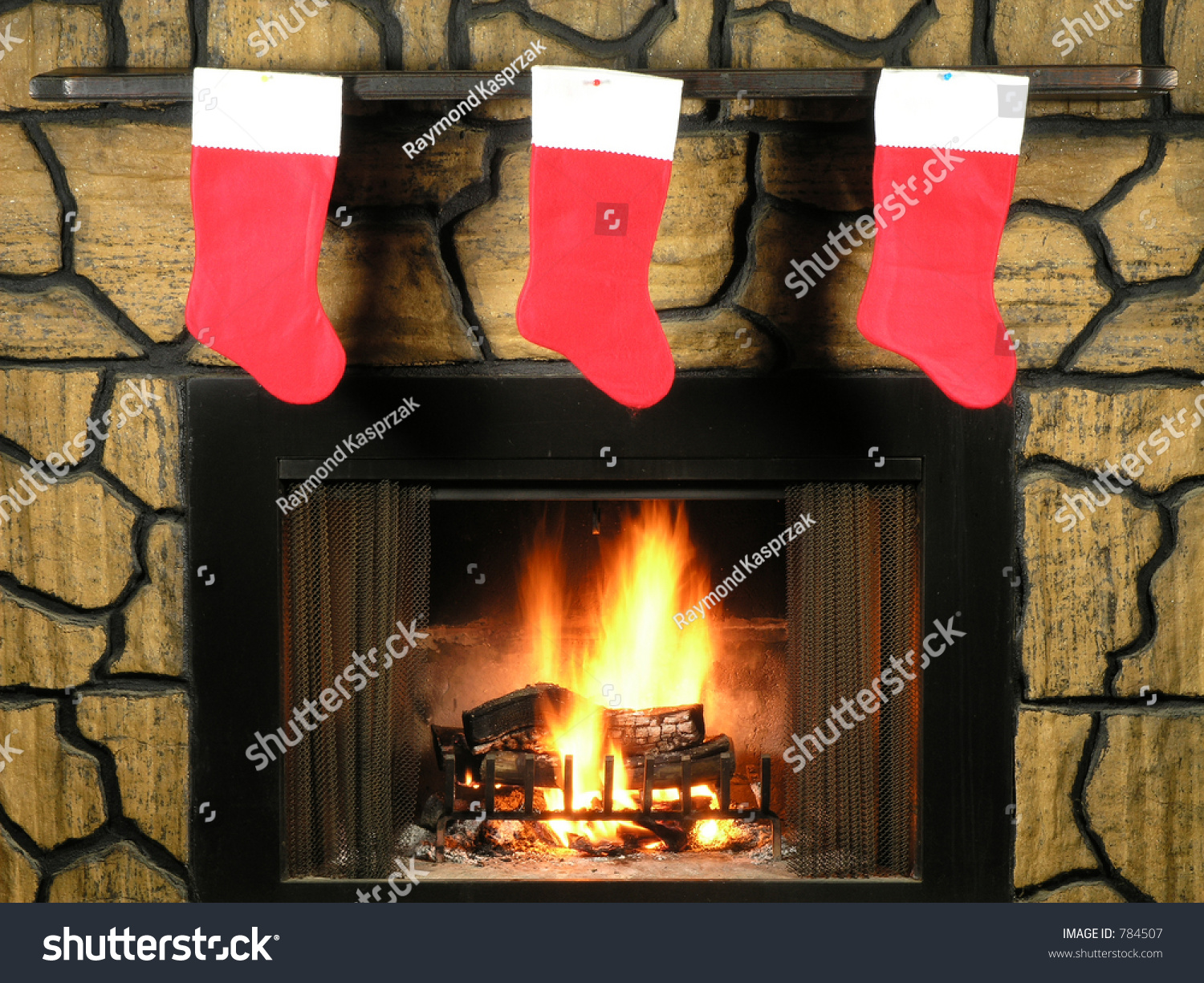 red christmas stockings hung by fireplace stock photo 784507