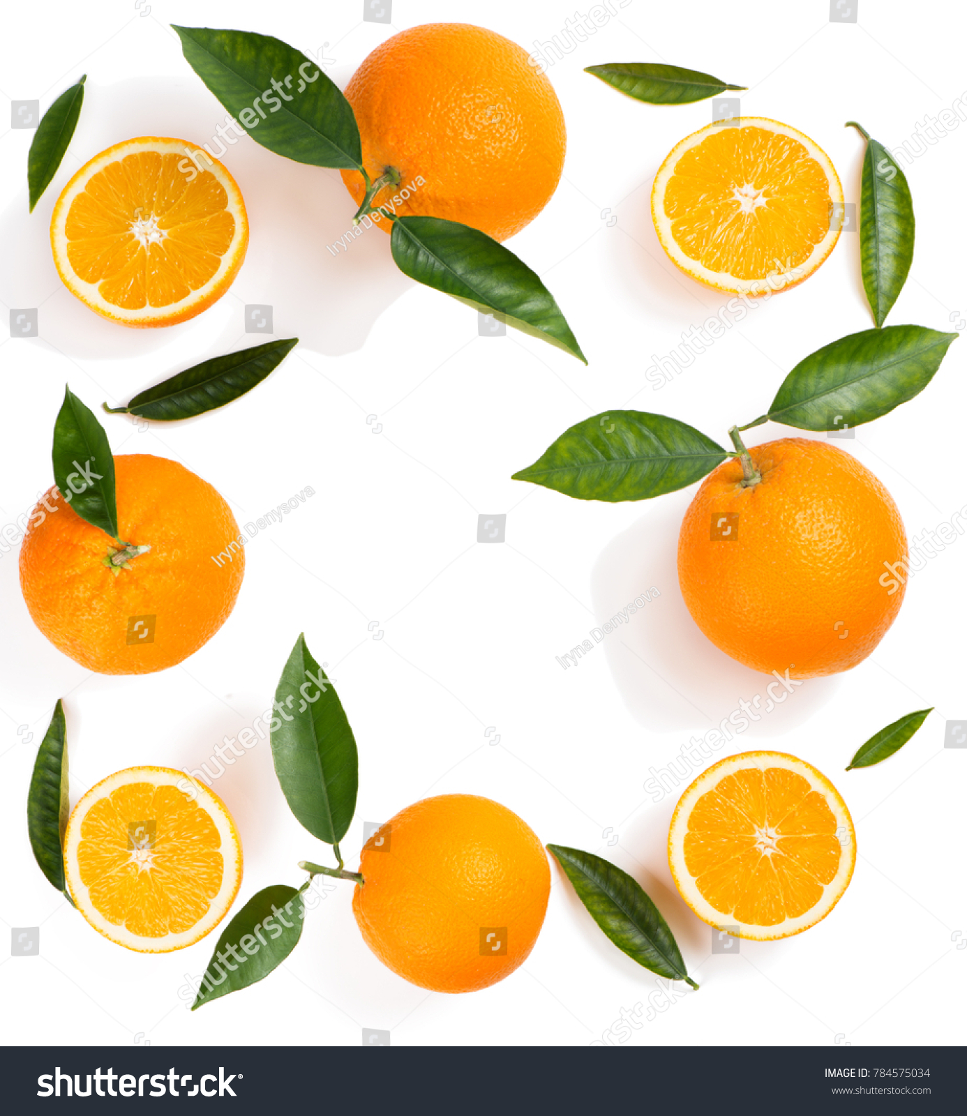 Composition of oranges and green leaves isolated on white background. Top view.
