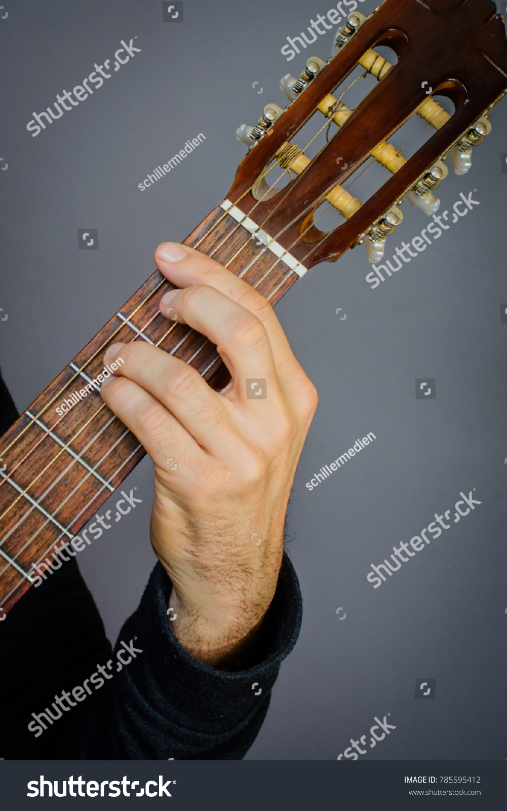 Guitarist Playing F Minor Chord On Stock Photo Edit Now 785595412