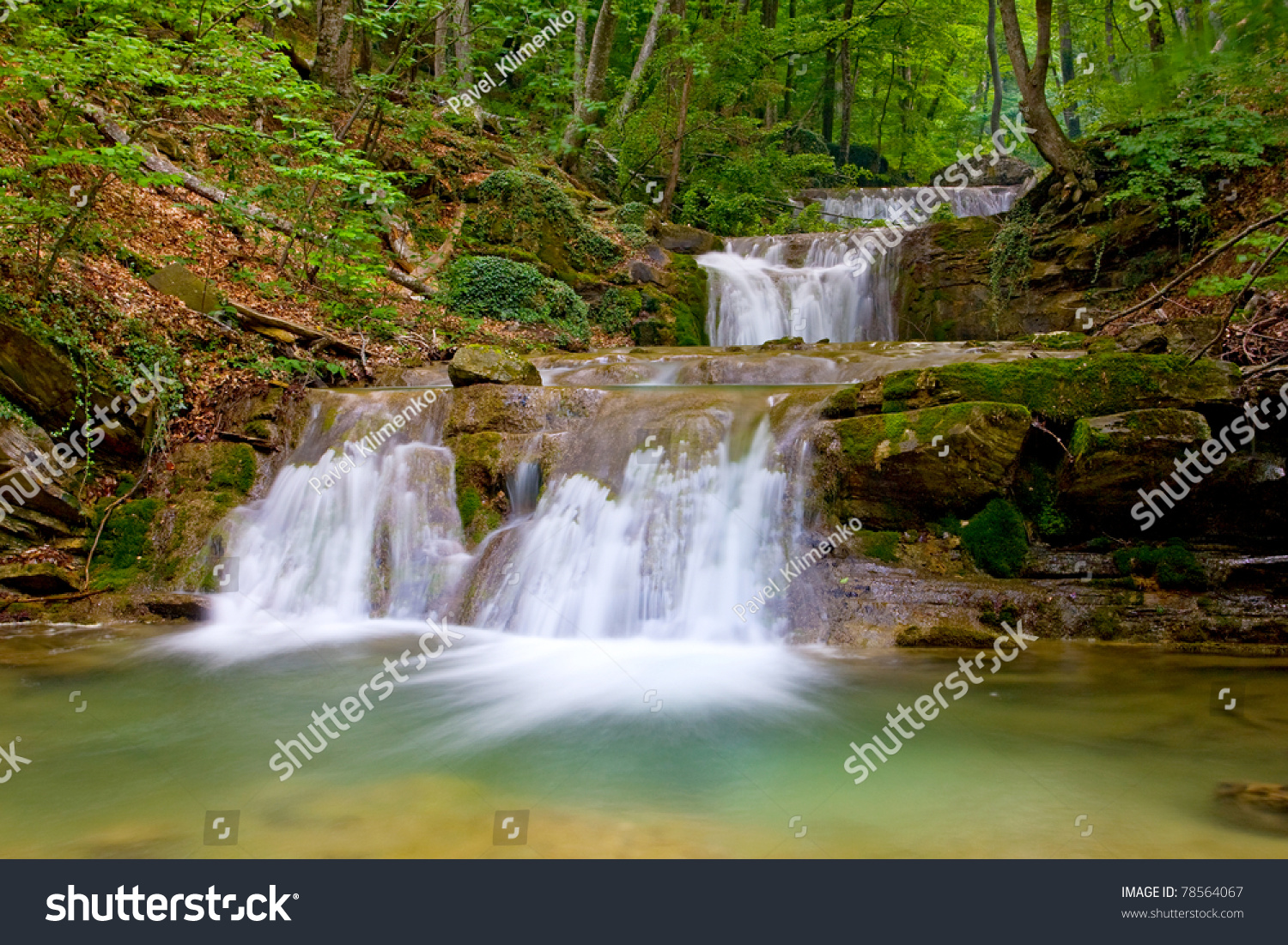 Nice Landscape With Waterfall In Green Forest Stock Photo