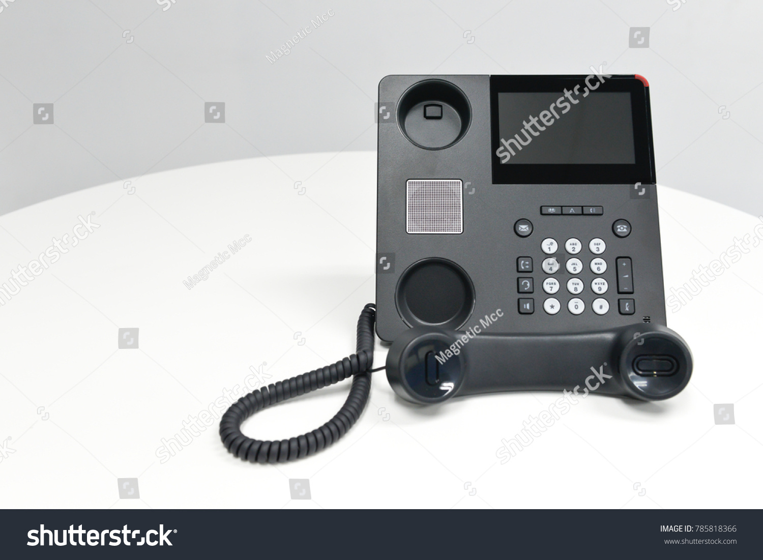 Black Ip Phone Office Phone On The White Table In The Meeting Room