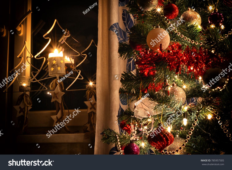 Burning Christmas Tree.Three Burning Christmas Candlesticks On Window Stock Photo