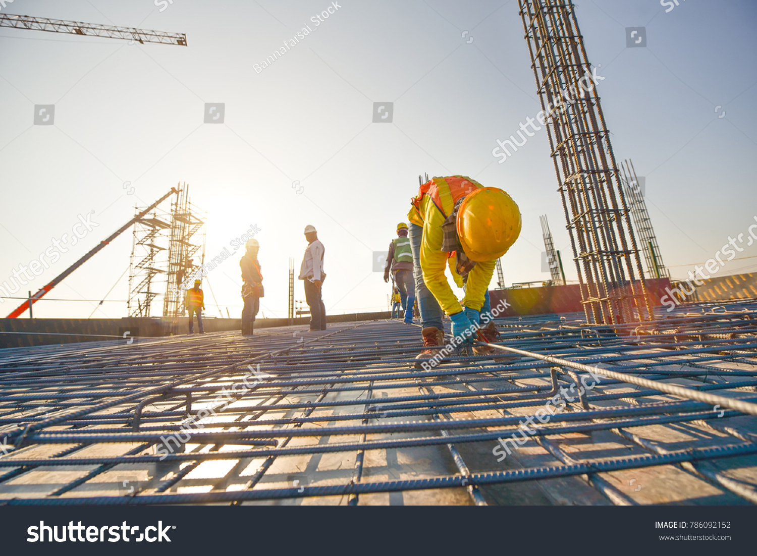 Construction workers fabricating steel reinforcement bar at the construction site #786092152