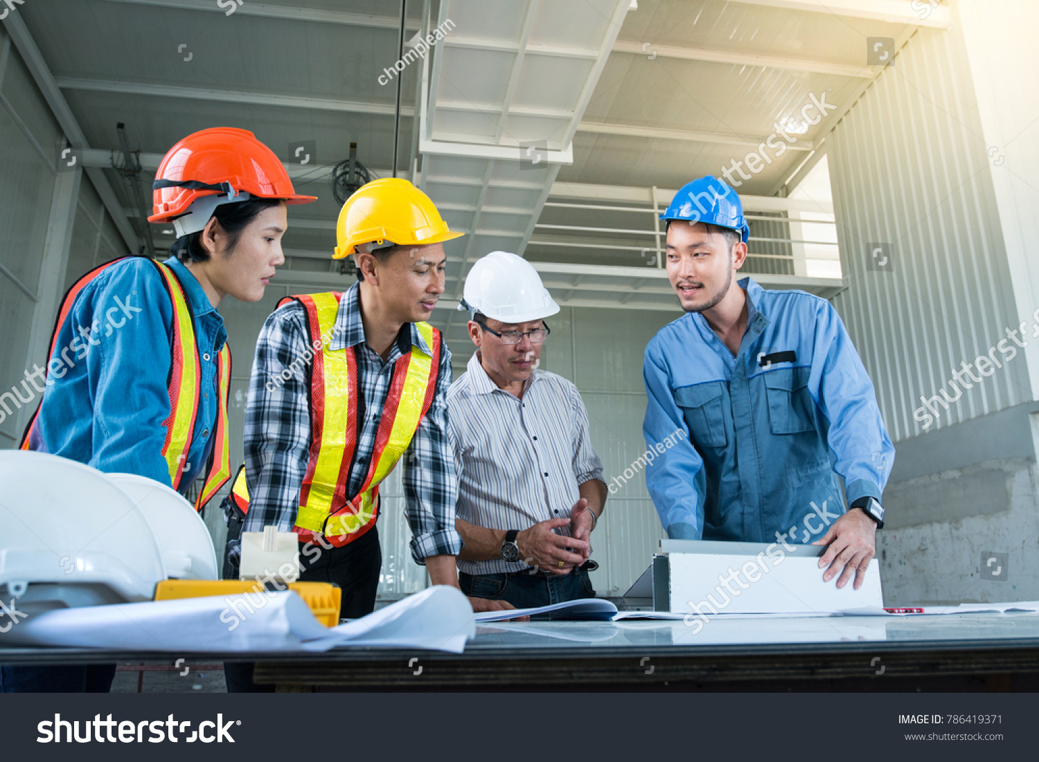 Engineer group meeting hardhats discussion construction stock photo engineer group meeting hardhats discussion construction stock photo royalty free 786419371 shutterstock malvernweather Images
