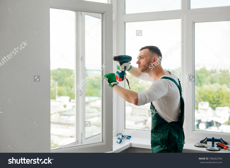 Focused Man Doing Window Repair Fixing Stock Photo (Royalty Free ...