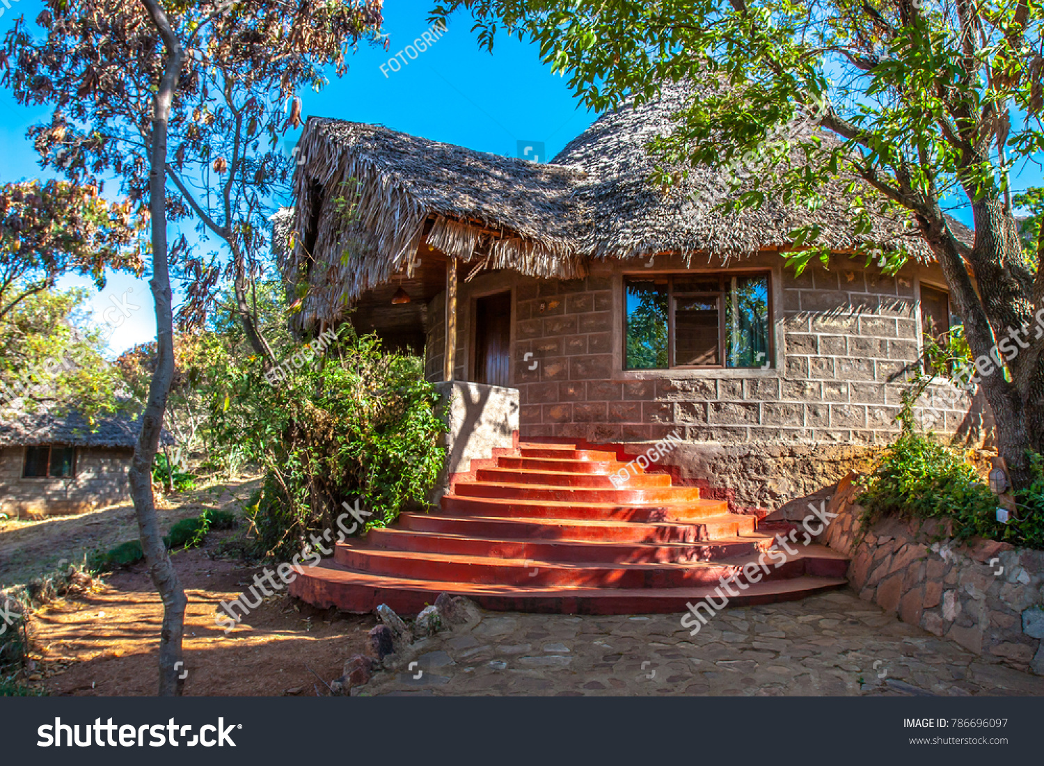 Kenya accommodation in kenya bungalow with a roof of a