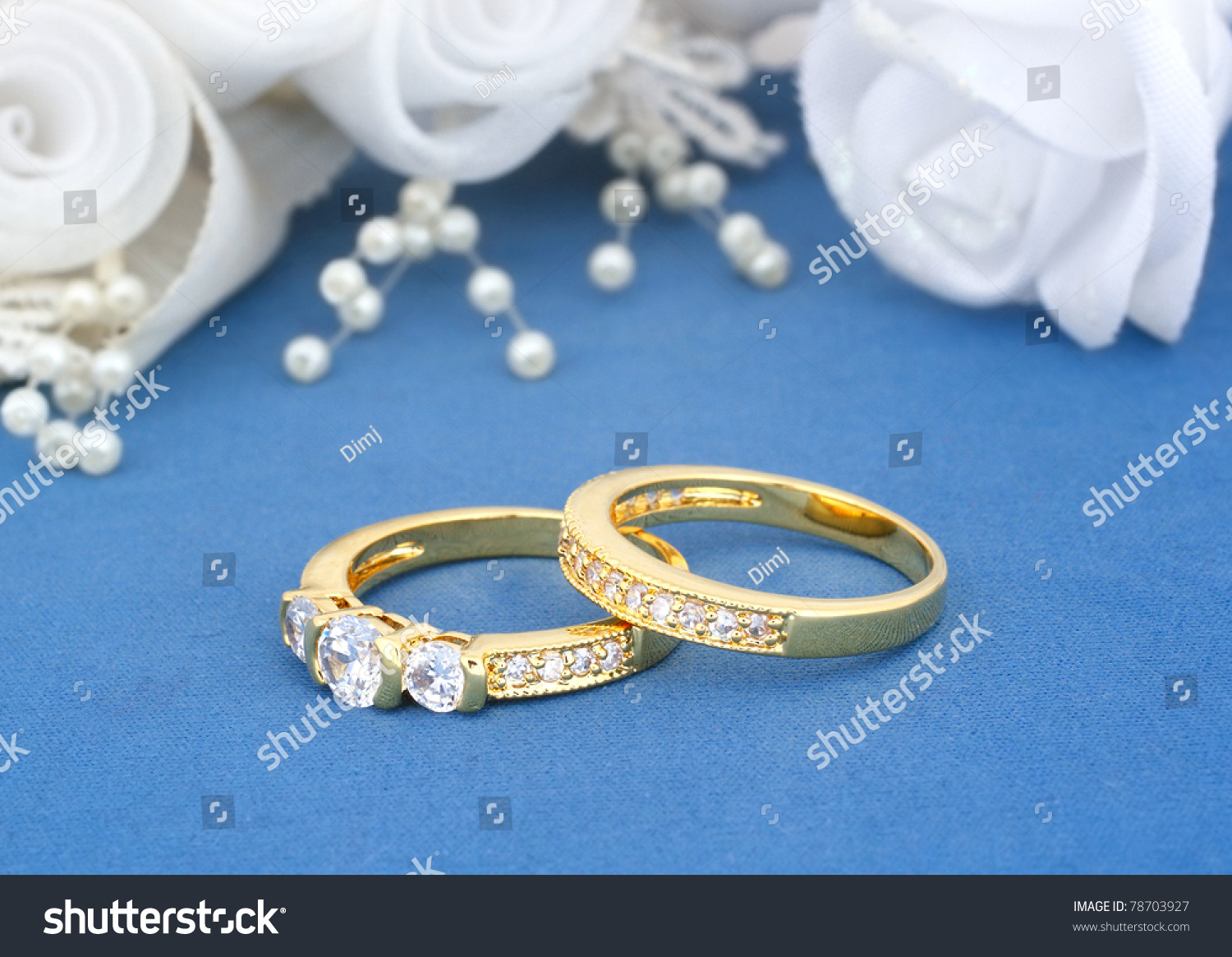 Wedding Rings On Blue Flowers Background Stock Photo Download Now