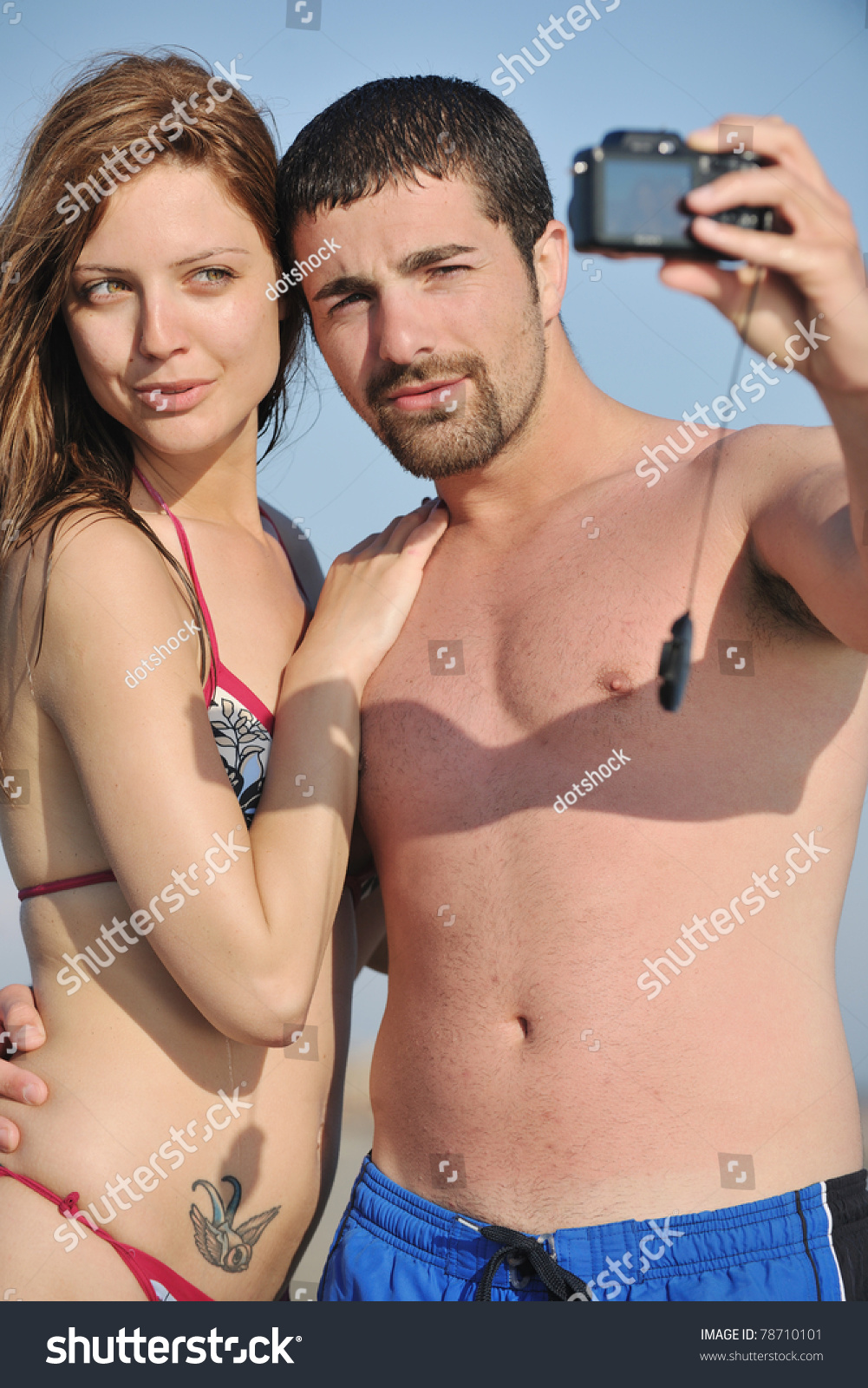 amateur young couple happy young couple in love taking amateur self portrait photos on beach