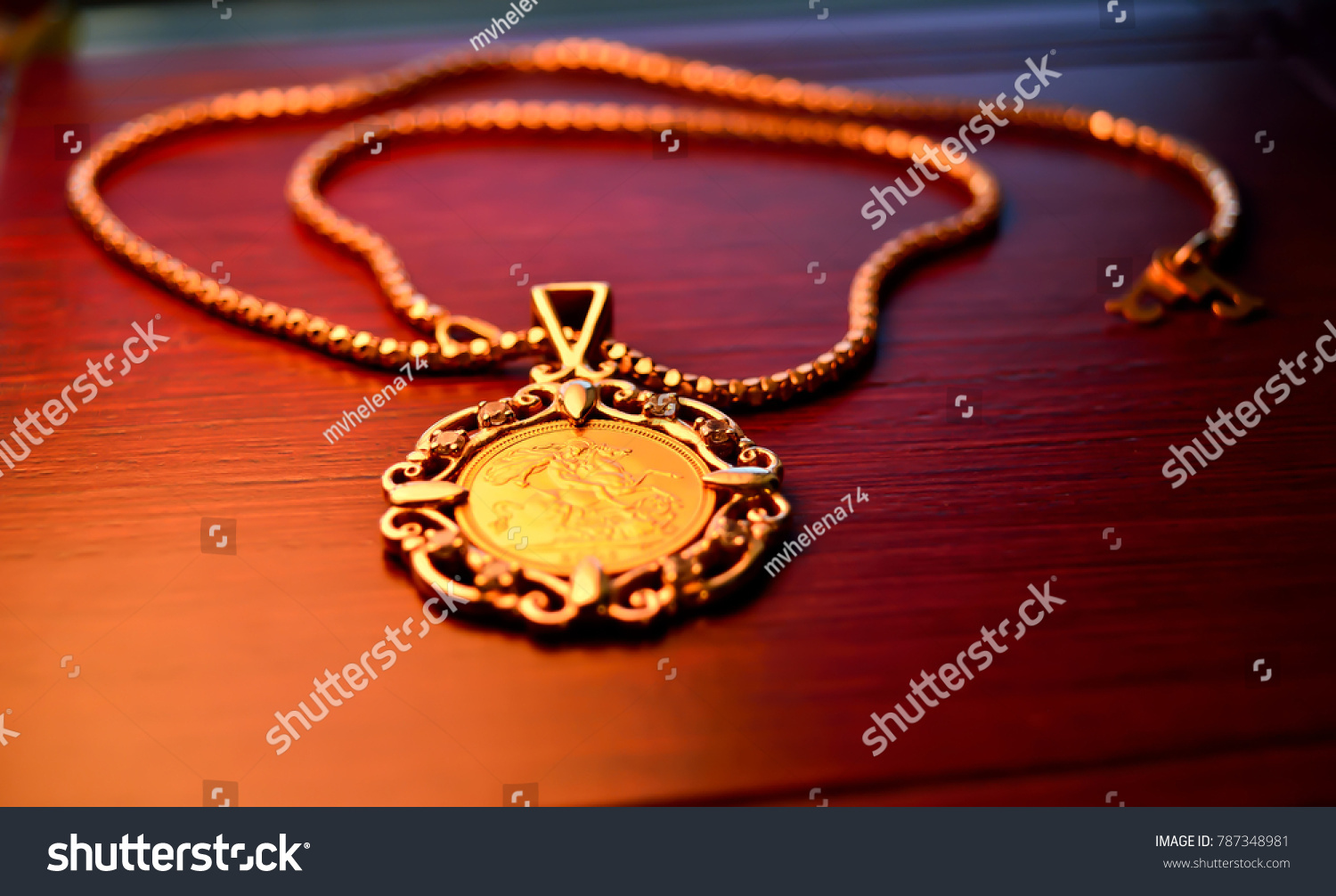 Gold sovereign coin jewelry pendant on stock photo royalty free gold sovereign coin as jewelry pendant on a chain aloadofball Images