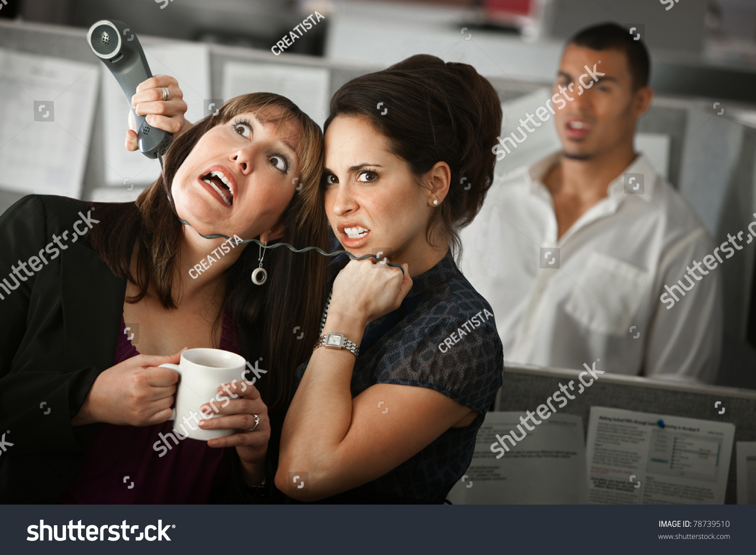 Frustrated office worker on the phone holding stock photo image - Frustrated Female Office Worker Strangles Her Coworker With A Telephone Cord