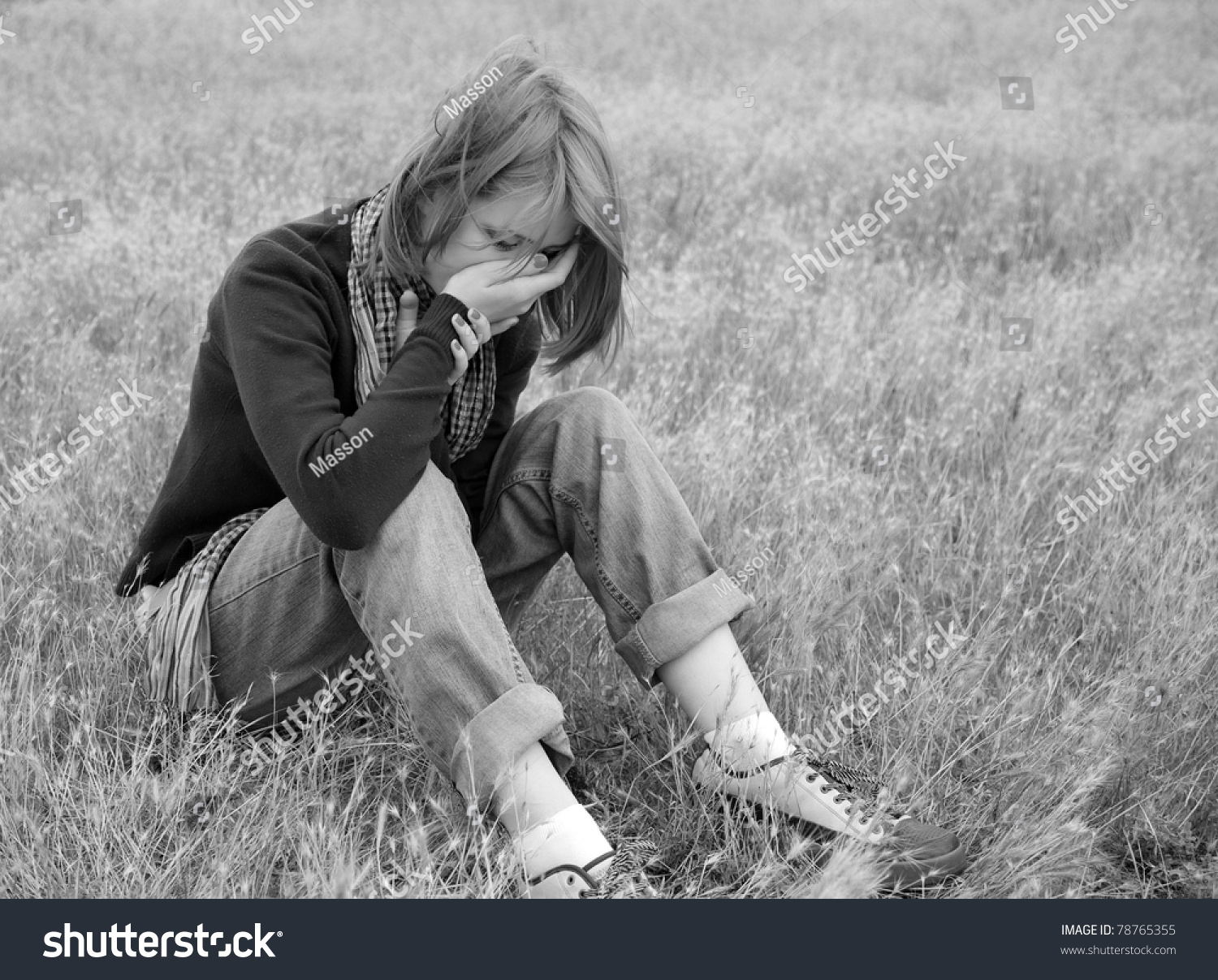 Lonely sad girl at field photo in back and white style