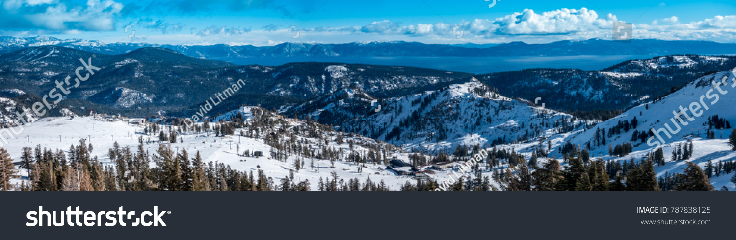 Panoramic view of the Sierra Nevada Mountains, with Lake Tahoe in the background, from the top of the Squa Valley Ski Resort, between Truckee and Tahoe City, on a partly cloudy winter day in December
