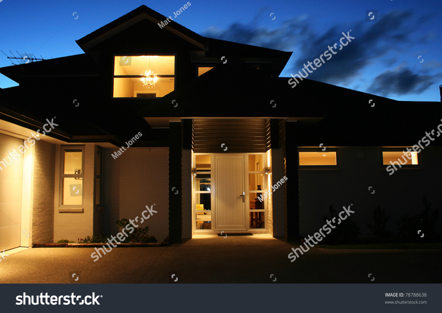 A modern house front entrance at night stock photo for Modern house at night