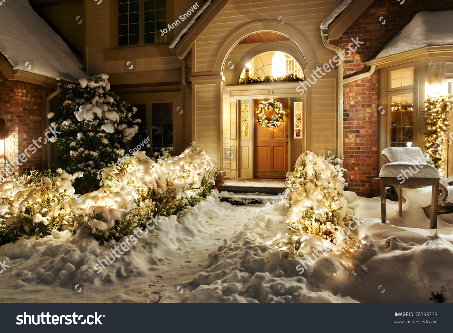 Front door christmas lights - Outside Christmas Lights Line Path To A Front Door On A Snowy Evening