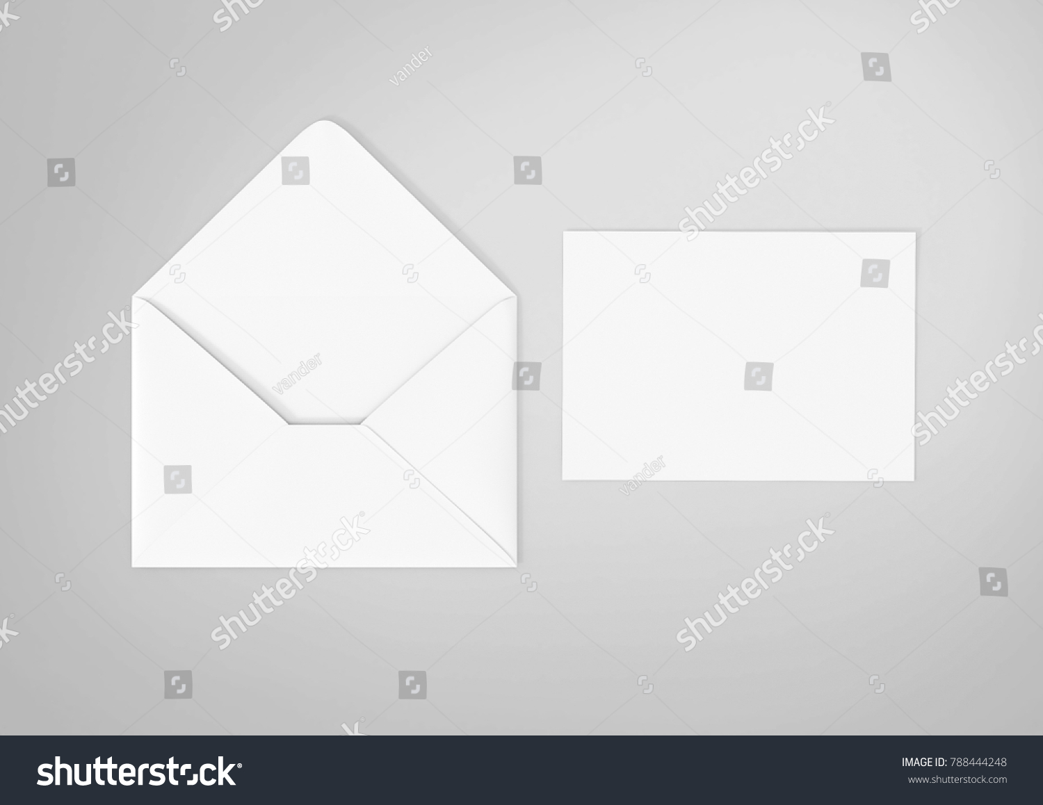 White envelope and post card on the white background, top view.