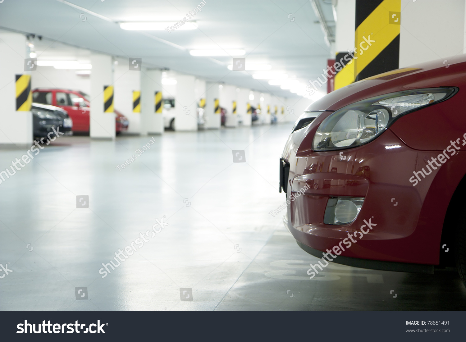 underground garage parking lot in a basement of house stock photo
