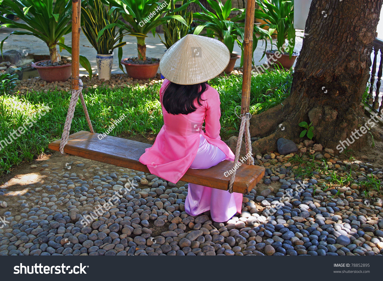 Woman in a national costume on a swing in Vietnam