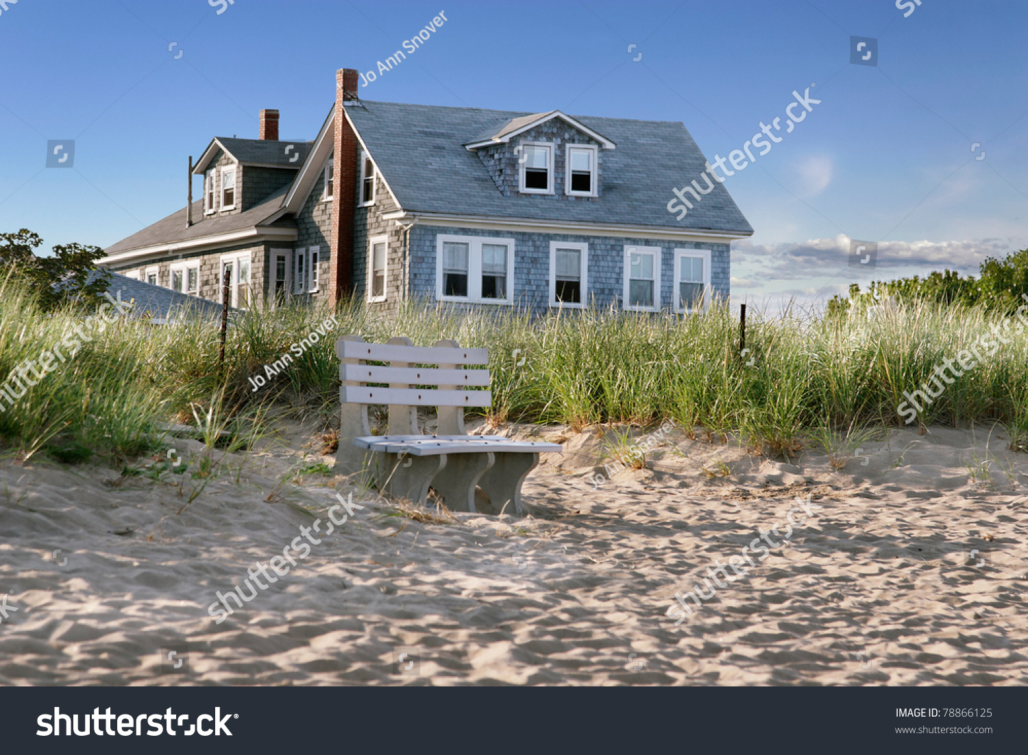 New England Beach Cottage Overlooking Dunes Stock Photo