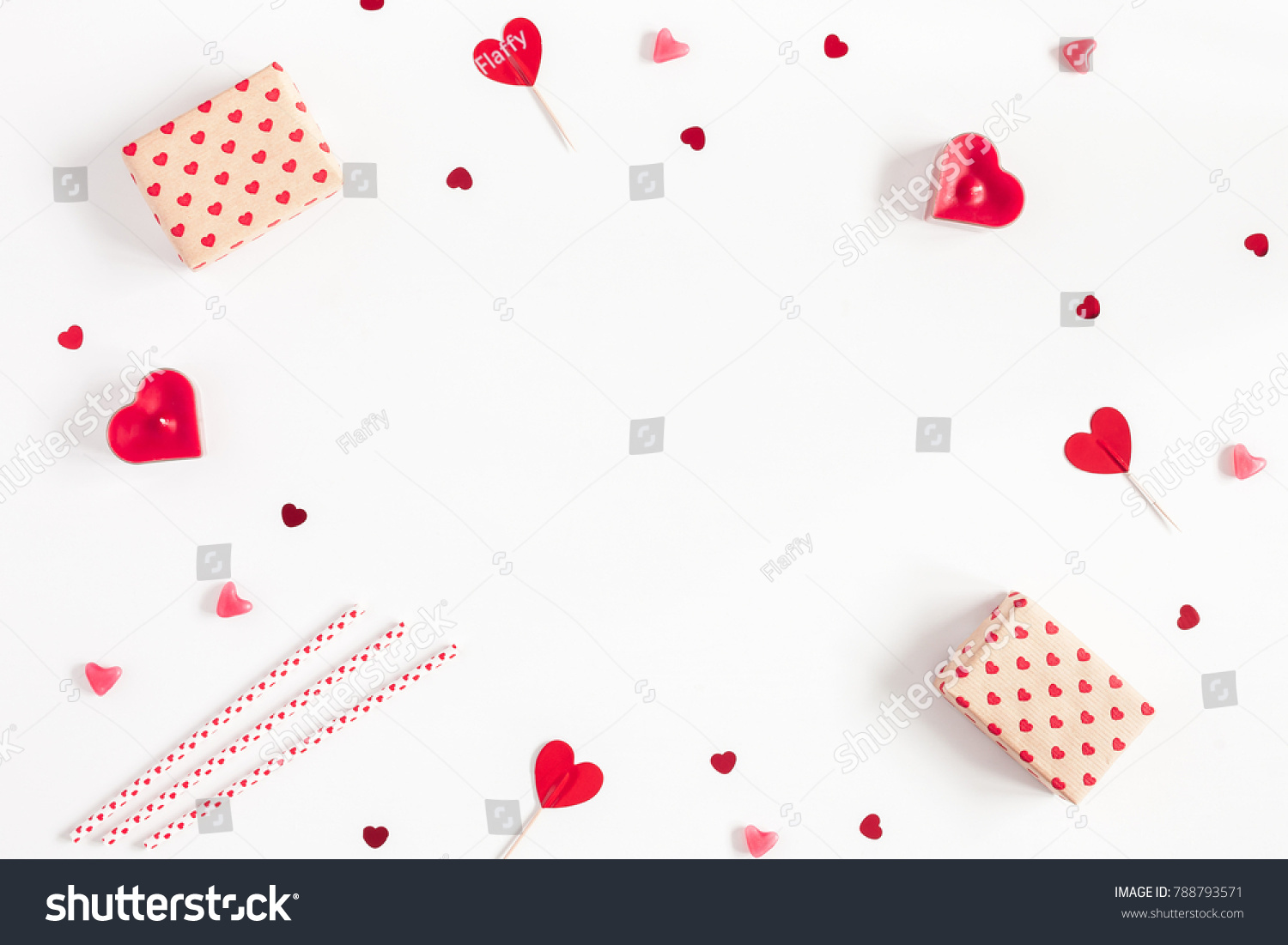 Valentine's Day. Frame made of gifts, candles, confetti on white background. Valentines day background. Flat lay, top view, copy space. #788793571
