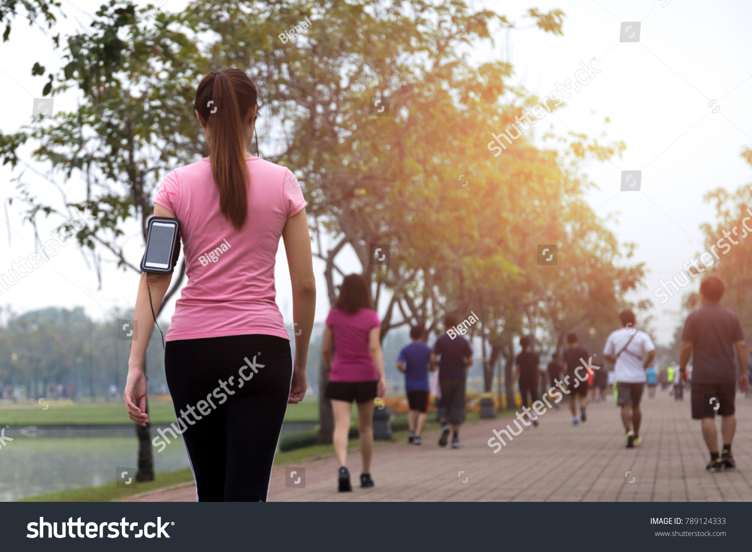 Group of people exercise walking in the park in morning