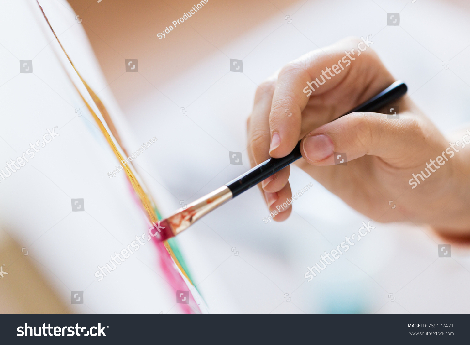 art, creativity and people concept - hand of artist with brush painting picture #789177421