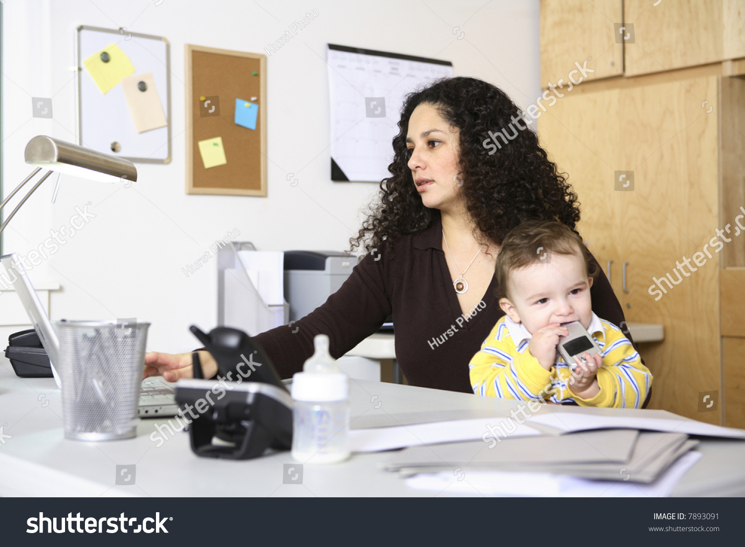 Outstanding Woman Working In Home Office With Baby Stock Photo 7893091 Largest Home Design Picture Inspirations Pitcheantrous